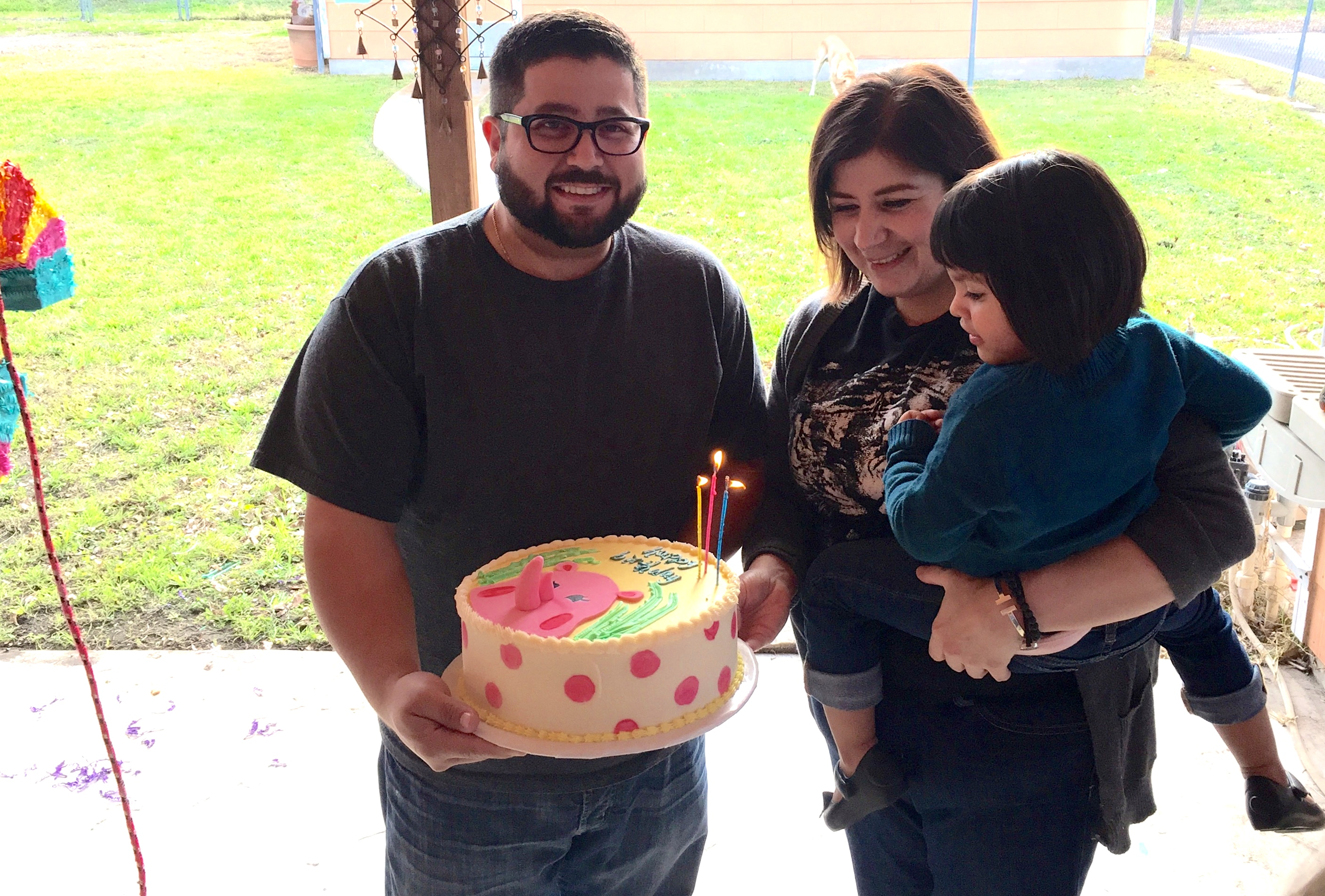 Milagro and her parents