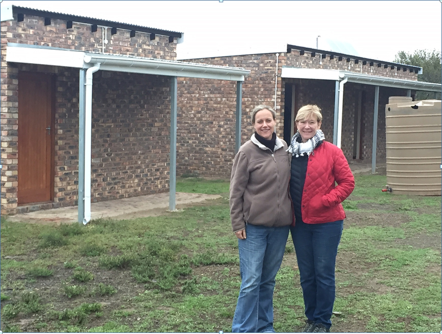 Figure 2. StopRhinoPoaching.com Director, Elise Daffue, and IRF Executive Director, Dr. Susie Ellis in front of a newly constructed guard post in Great Fish River Nature Reserve.